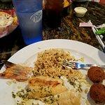 Hogfish snapper in garlic & lemon butter sauce, rice pilaf & hush puppies