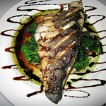 Grilled Branzino over Sauteed Spinach