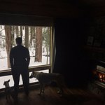 Enjoying the toasty cabin but also soaking in the view