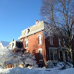 The stately facade of the West End Inn, wintertime