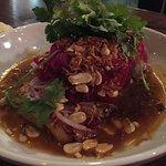 Seared Chicken Thigh with caramelized palm sugar red curry sauce, and pickled red cabbage on top
