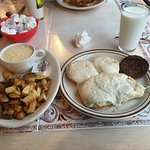 Biscuits, gravy, sausage potatoes and grits.