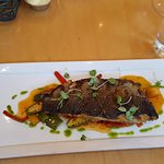 Grilled branzino on a bed of okra, pineapple, red pepper in tamarind sauce