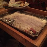 "When you order the whole fish it comes buried in salt and your waiter ""excavates"" as you watch."