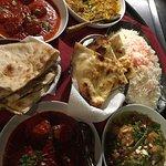 Scallops tikka massala , vegetable korma , eggplant and potato curry , nan bread and basmati ric