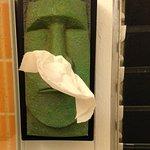 "The awesome ""tiki man"" Kleenex dispenser in the bathroom."