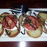bruschetta with tomato & mozzarella cheese and a balsamic drizzle