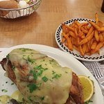 half roasted chicken, stuffing, gravy, sweet potato fries