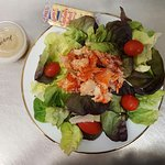Maine Lobster Salad on a Bed of Greens with Grape Tomatoes and Champagne Vinaigrette on the Side