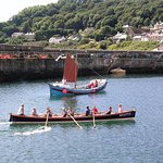 Gig racing and a traditional sail boat in the harbour