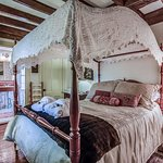 The Marie room is on the first floor, has a full size antique canopy bed, full bath, & sherry.