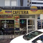 Left side is a convenience store (with grumpy young clerk); right side is Cafetería Tropical.