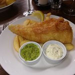 Fish (of the day) with chips, pea puree and tartare sauce.