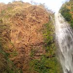 Snapshot of the peak of the waterfall along the mountain. Bats sanctuary alongside the fall