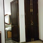 Wonderful double doors in teak with heavy brass fittings