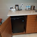 Nice roomy fridge, coffee maker, and complementary water