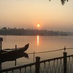 Sunrise over the backwaters trip by tradional boat from garden of hotel