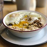 'The Vermonter' 2 eggs over easy on house made oatmeal.