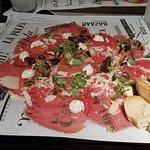 Veal carpaccio with parmesan and cherry mozzarella cheese