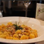 Home-made gnocchi with pumpkin sauce and hazelnuts