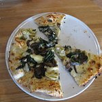 half of the pizza is gone - thin, mushroom, white sauce, artichoke hearts, smoked cheese