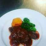 Duck breast with sweet potato fondant, stemmed broccoli and plum sauce