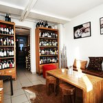The cosy lounge-area: Eat and drink sourrounded by our selction of wines