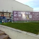 The 20th Century Decorative Arts Fair banner in front of the building