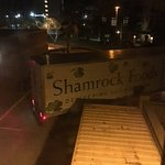 5:05 AM Shamrock Foods delivery truck backing into the loading dock.