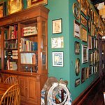 Old photos, books, signs, and paintings line the walls