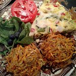 Sample Breakfast - Fritata, with potato stacks, fresh greens with fruit and balsamic drizzle