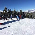 Crowd waiting for their turn to go down the terrain park