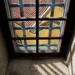 the one window inside the spiral staircase leading up to the roof