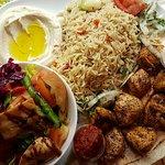 grilled chicken breast :chicken tawook plate  with rice hummus fattoush salad hummus fresh pita