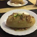 Cepelinai, a potato-based dumpling dish characteristic of Lithuanian cuisine.