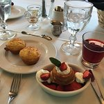 Breakfast starter course: cornmeal muffins, cranberry juice, fresh strawberry shortcake with cre