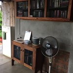 Shared patio with books and fridge