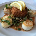 Perfectly seared, creamy scallops with risotto cake