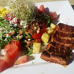 Arugula, melon and tomato salad add Ahi. Very nice salad.