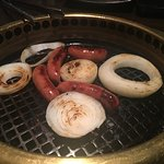 Grill going with Japanese pork sausages and sweet onions!