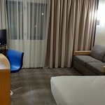 Standard room with double bed and sofa