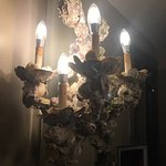 The art is different- the oyster chandeliers atrociously nasty & has hair in them, the house kee