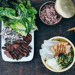 Smoked hanger steak lettuce wraps along with koji-marinated pork belly rice cake wraps.