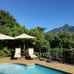 Relax next to our sparkling pool overlooking the mountain.