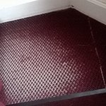 Again thread bare carpet with mat over even worse part