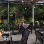 Our all season dining terrace affords a beautiful view of the gardens