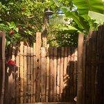 Outdoor showers at Oneta Resort