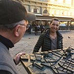 My father looking at the city map of Firenze in the piazza.