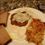 Country fried steack and eggs. Nice way to start the day!