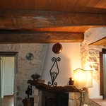 Beautiful wood beams, stone wall and a fireplace.